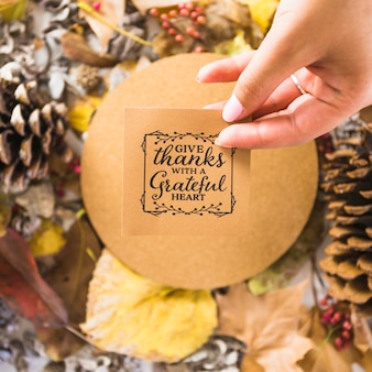 Hand holding thanksgiving note