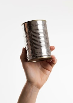 Hand holding tin can