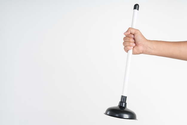 Hand holding toilet black rubber plunger or toilet suction cup
