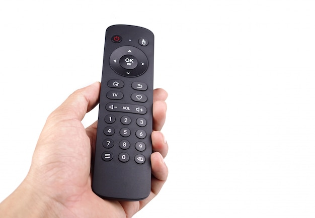 Hand holding tv remote control with isolated white background.
