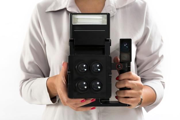 Hand holding vintage instant camera