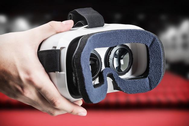 Hand holding virtual glasses