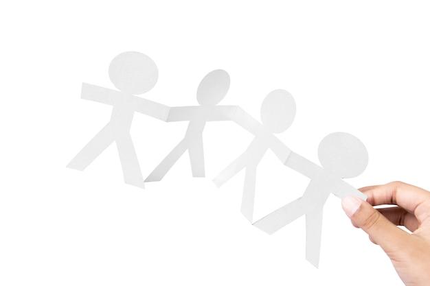 Рука бумаги белых людей, взявшись за руки с белым фоном. концепция всемирного дня народонаселения