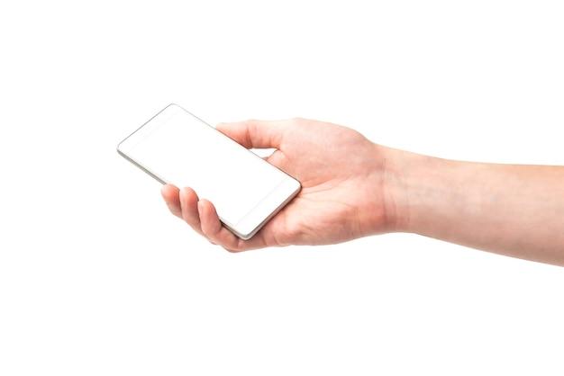 孤立した白い背景画面と白いスマートフォンを持っている手