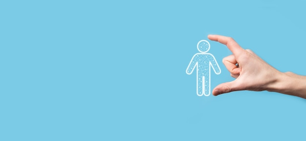 Hand holds man person icon on dark tone background.hr human ,people icontechnology process system business with recruitment, hiring, team building. organisation structure concept.