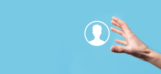 Hand holds user person icon interface on blue background.user symbol for your web site design, logo, app, ui.banner.