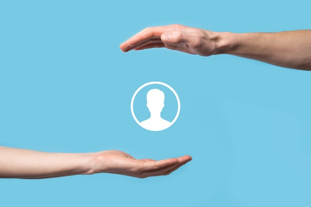 Hand holds user person icon interface on blue background.user symbol for your web site design, logo, app, ui.banner