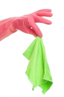 布を保持しているピンクの手袋で手します。