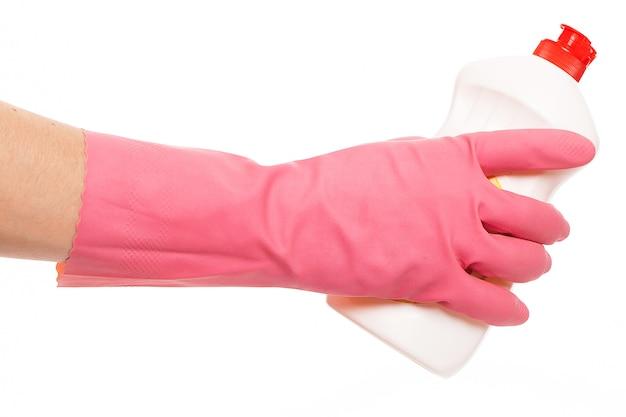 液体を保持しているピンクの手袋で手します。