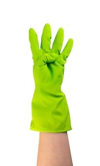 分離された緑色の保護ゴム手袋を手に入れます。 4本の指で手袋をはめた手を上げた