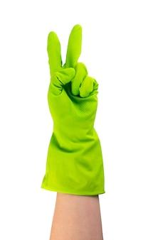 分離された緑色の保護ゴム手袋を手に入れます。 2本の指で手袋をはめた手を上げた
