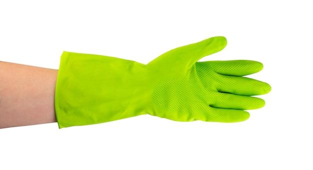 分離された緑色の保護ゴム手袋を手に
