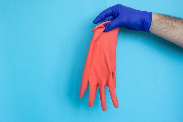 ラテックス手袋をはめて、衛生保護コロナウイルス