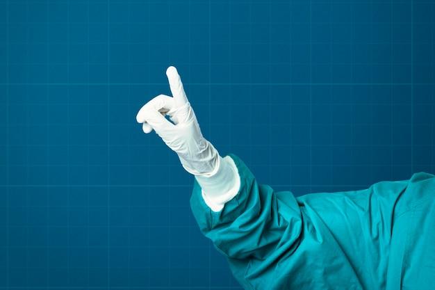 Рука в медицинской перчатке показывает указательным пальцем медицинские технологии