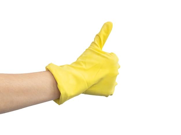Рука в желтой резиновой перчатке, концепция очистки, символ жестов ок, большой палец вверх, изолированные на белом фоне фото