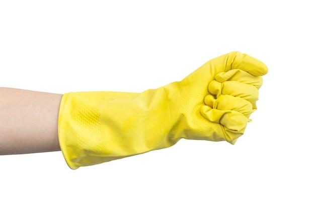 Рука в желтой резиновой перчатке в жесте сжимающего кулака, изолированном на белом фоне фото