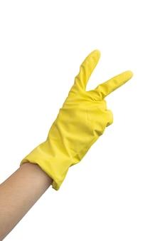 Рука в желтой резиновой перчатке, делая жест, изолированные на белом фоне фото