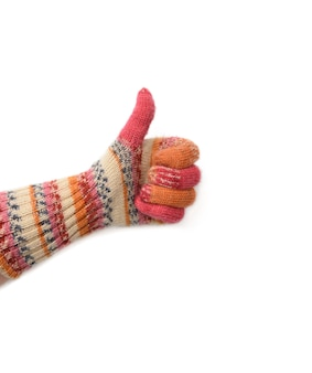Hand in knitted mitten isolated on white, like gesture