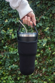 Hand on large water bottle for keeping temperature
