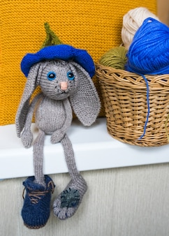 Hand made knitted sad hare, knitted toys