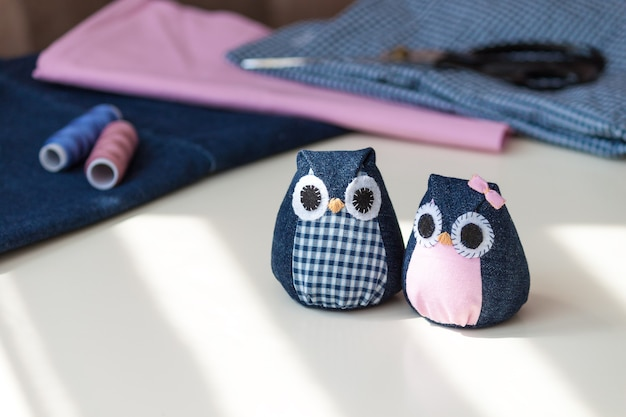 Hand made owls craft tools and materials on the table