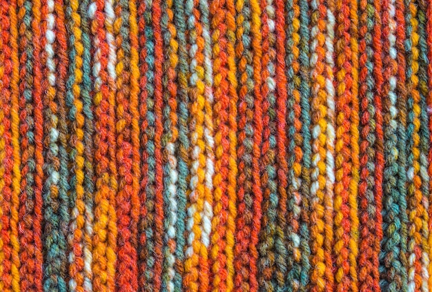 Hand made snug cozy knitting textile background, wool scarf texture