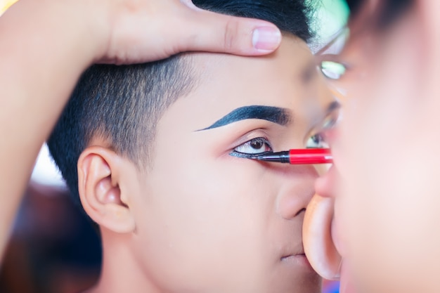 Hand of make-up master, the makeup artist does makeup for the bride
