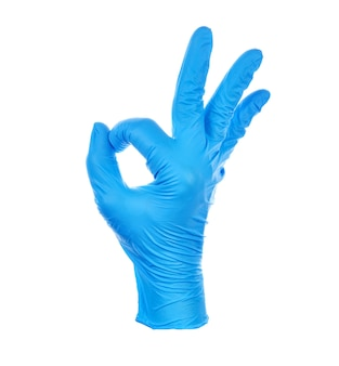 Hand making okay wearing a blue nitrile medical glove symbol.