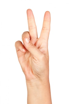 Hand making the sign of victory isolated on white background