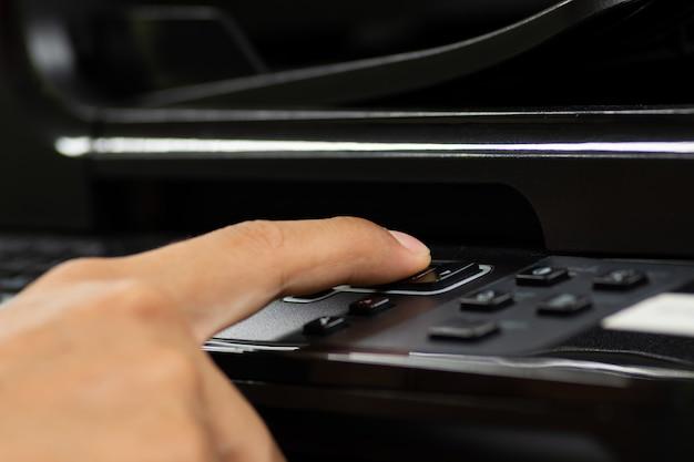 Hand male using printer.