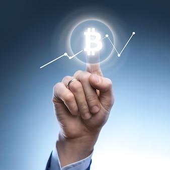 The hand of a man clicks icon bitcoin on virtual screen