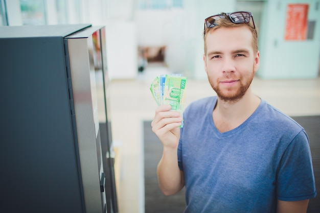 Hand man insert card to atm machine, banking and financial concept