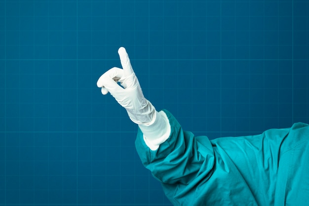 Mano nel guanto medico che mostra la tecnologia medica del dito indice