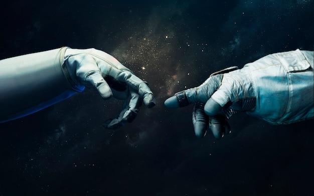 Рука космонавта и робота. научно-фантастические обои. элементы этого изображения, предоставленные наса