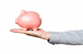 Hand of man holding holding a piggybank
