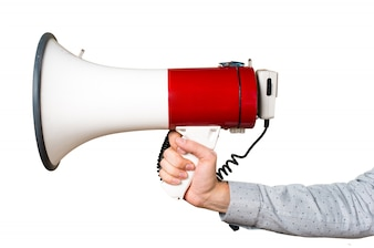 Hand of man holding shouting by megaphone