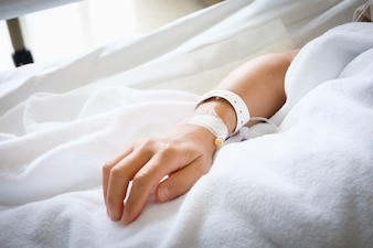 Hand of Patient that sleeping in hospital bed
