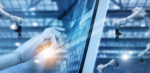 지능형 공장 산업 모니터링 시스템 소프트웨어의 제어판에서 작업하는 로봇의 손.