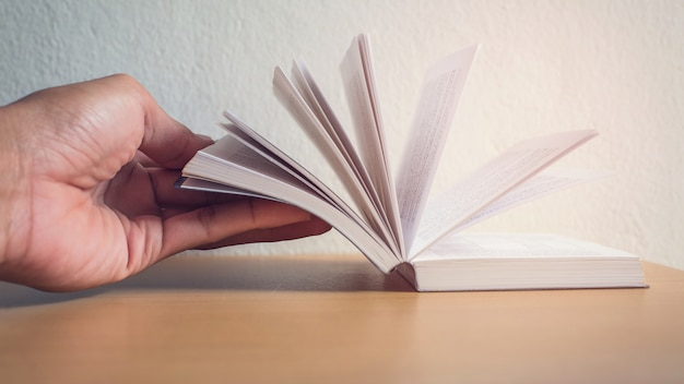 Hand open a book for reading