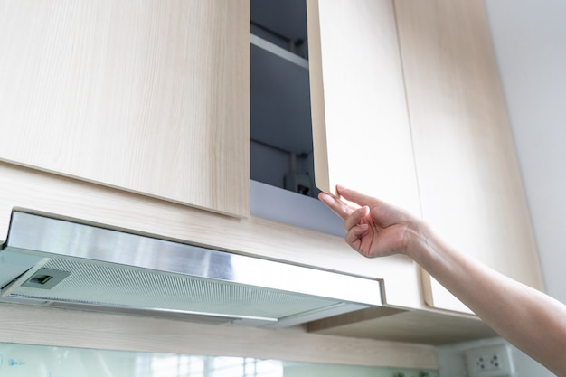 Hand open kitchen cabinet