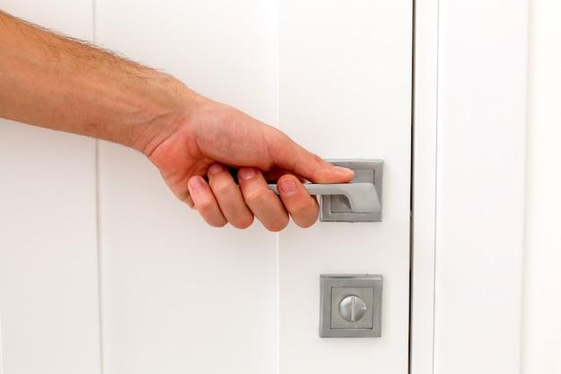 Hand opens the door handle