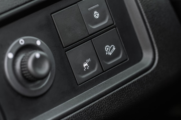Hand operating electronic stability program. esp control close up view. interior detail of a modern car.