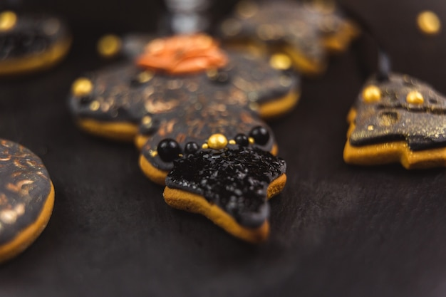 Hand painted christmas gingerbread on a black . close-up.