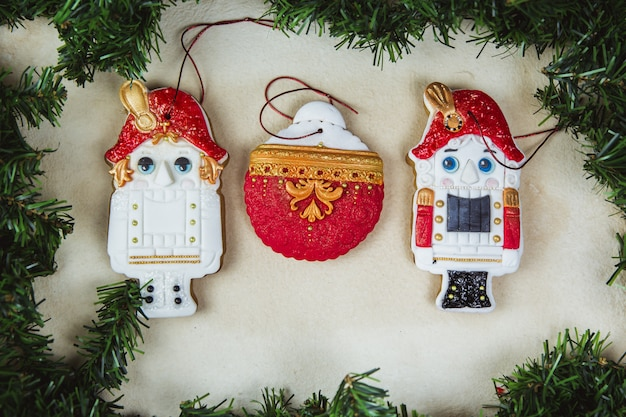 Hand painted christmas gingerbread nutcracker on a beautiful beige . card . top view. flat lay.
