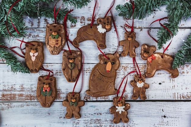 Hand painted christmas gingerbreades bear family on a beautiful wooden . card . top view. flat lay