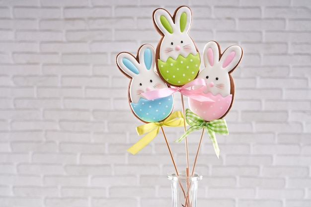 Hand painted gingerbread bunnies on wooden sticks