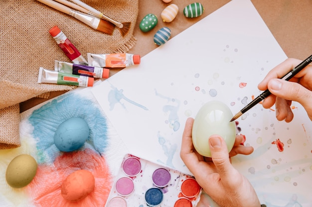 Hand painting egg with brush