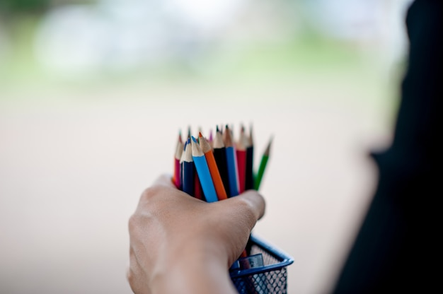 Hand and pencil pictures, green background color education concept
