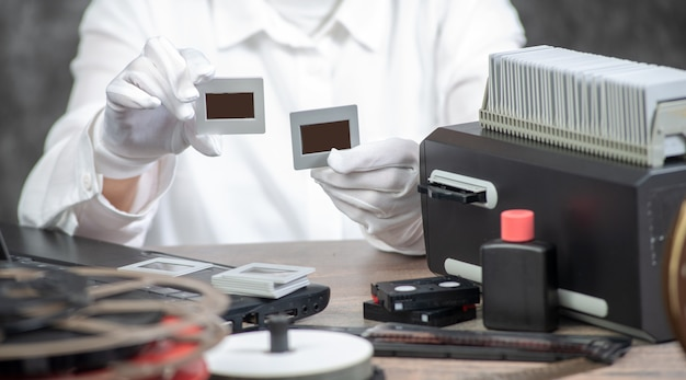 Hand photographer digitize film slide for saving