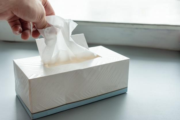 Hand picking white tissue paper